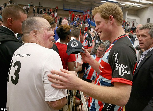 Prince Harry meets wounded veterans and Warrior Games competitors after a seated volleyball exhibition match