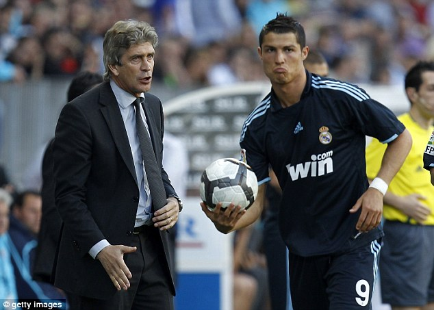 In the limelight: Pellegrini lasted just a season at Real Madrid and dealt with the likes of Cristiano Ronaldo (below)