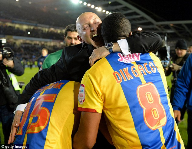 We're going to Wembley: Ian Holloway celebrates a stunning away win with Kagisho Dikgacoi and Mile Jedinak