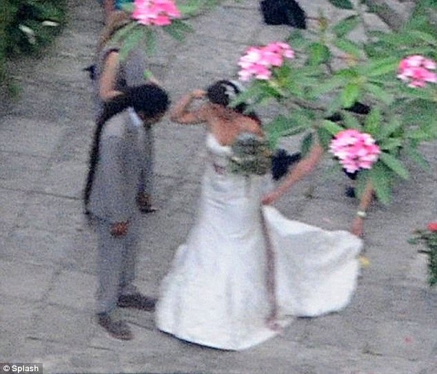 Happy couple: Lindsay Boehner celebrates after marrying construction worker Dominic Lakhan in Florida on Friday. The groom was previously arrested for possession of marijuana.