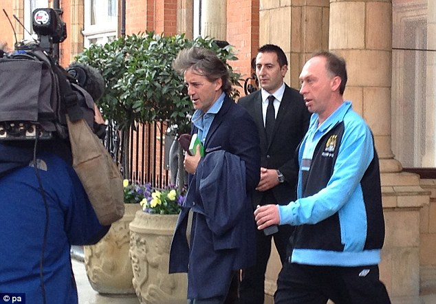 Heading for training: Roberto Mancini leaves their hotel in London to head to Loftus Road for training