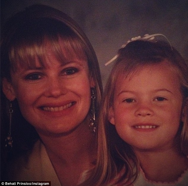Tiny tot: Behati Prinsloo shared a portrait of herself sitting on her mother's lap