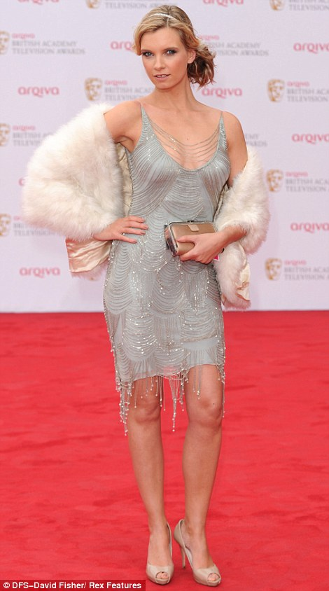 Gatsby style: Model Ruth Crilly took inspiration from the 1920s in a cute light coloured cocktail dress for the event