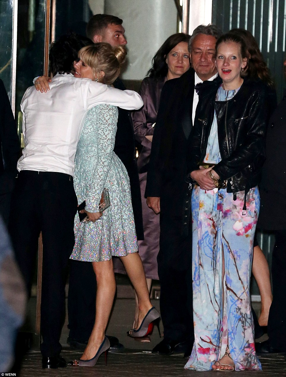 Nice to see you: Actor Ben Whishaw gave Sienna a big hug as the two stars bumped into each other