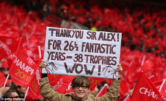Show of support: One Manchester United fan held up his tribute to the club's great manager during the match against Swansea on Sunday