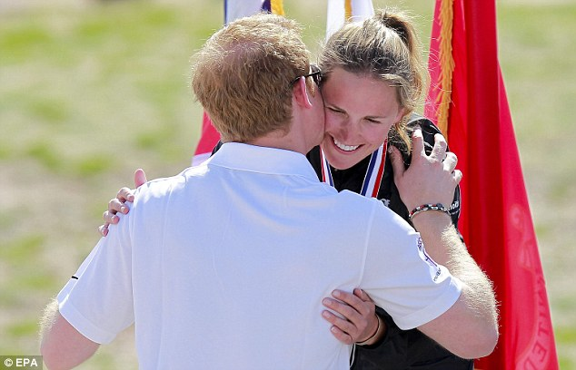 Well done: Harry kisses Margaux Mange after presenting her with her silver medal for the Women's Bicycle Open, at the 2013 Warrior Games