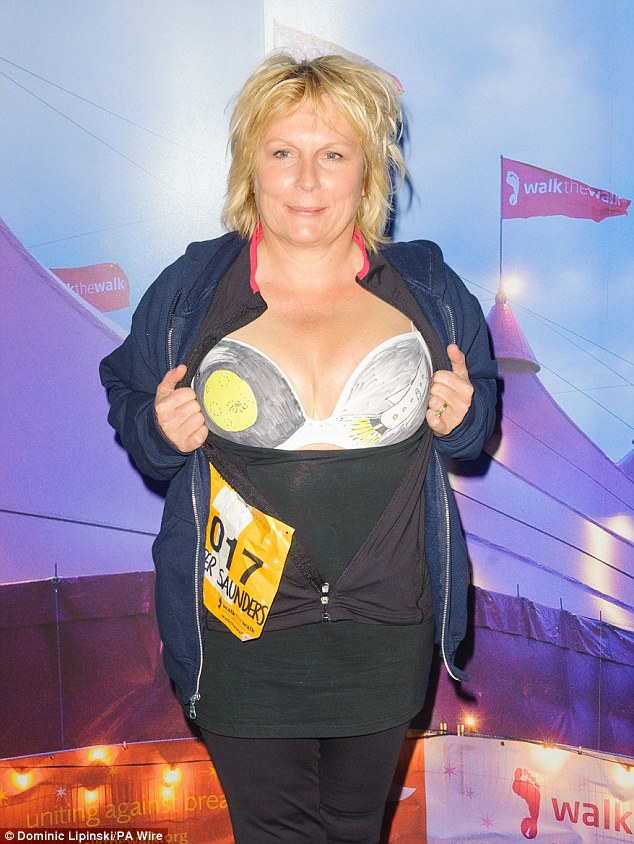 Cleavage for charity: Jennifer Saunders exposed her bra as part of the Moonwalk London event on Saturday night, raising money to help fight breast cancer