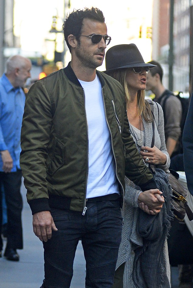In the shade: Jennifer and Justin see eye-to-eye behind their trendy shades
