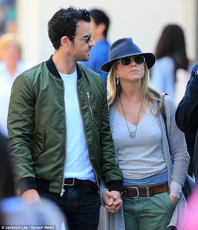 Intimacy rating: The A-list star leaned into her man as they strolled down Madison Avenue and gripped his hand firmly in hers, showing that they are very much in love