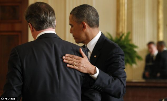 Barack Obama gives David Cameron a friendly pat on the back as they depart after a joint news conference