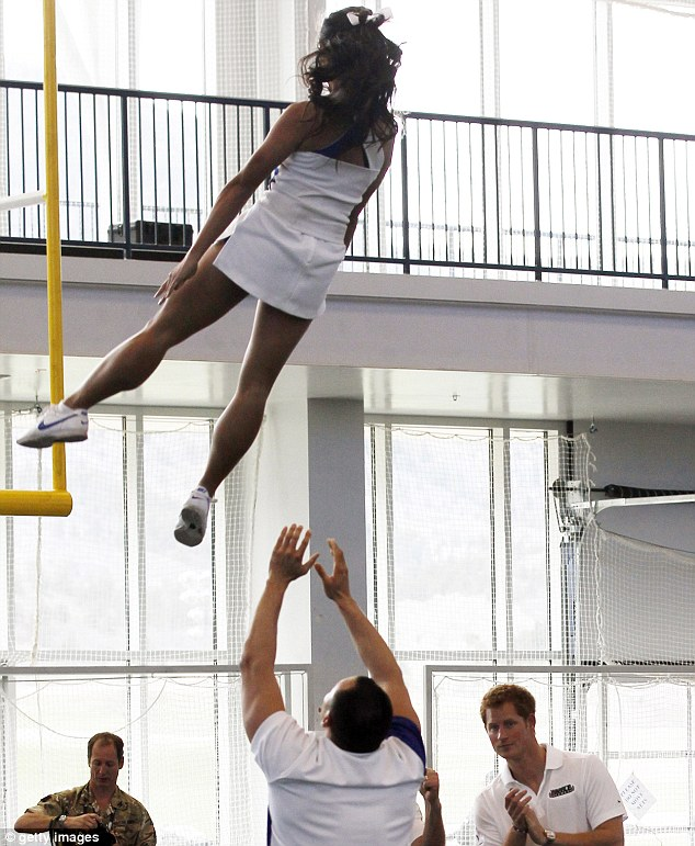 Cheer leader: Harry (bottom right) watches a gymnastics display