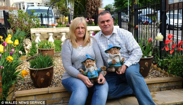 Julian and Denise Barry, with some of their award-winning gnomes. Clay ornaments have been stolen from their garden on three occasions