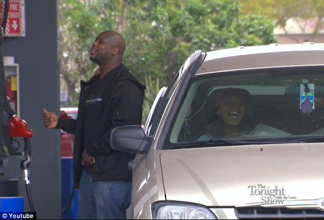 Acting: His wife Monifa is sitting in the car pretending to be mortified but now it was revealed that she previously had a similar situation happen to her at the same gas pump