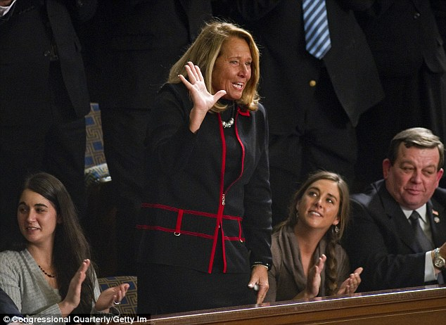 Proud: Debbie Boehner, accompanied by her daughters Tricia (on the left) and Lindsay (on the right) waves as outgoing House Speaker Nancy Pelosi, D-Calif., recognizes her before handing the gavel over to husband House Speaker John Boehner in January 2005.