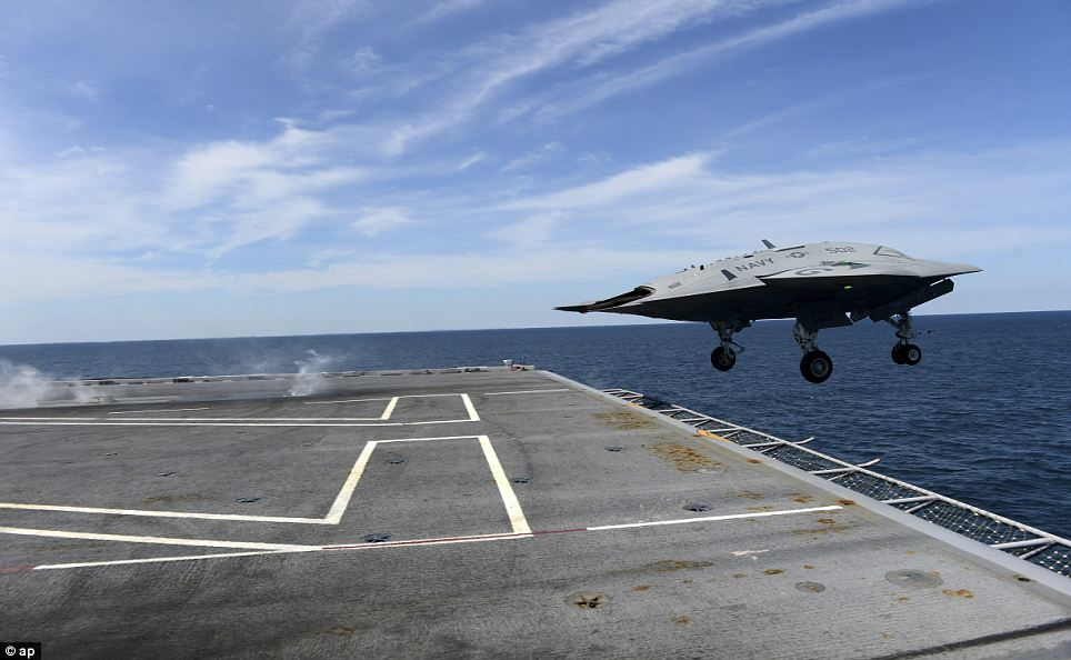Lift off: The drone takes off from the end of the George H.W. Bush's flight deck