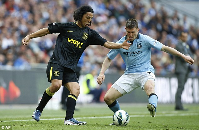 Back in the side: James Milner (right) starts for Manchester City