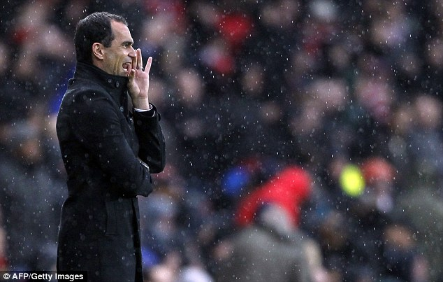 Calling the shots: Wigan boss Roberto Martinez instructs his players from the Emirates Stadium touchline