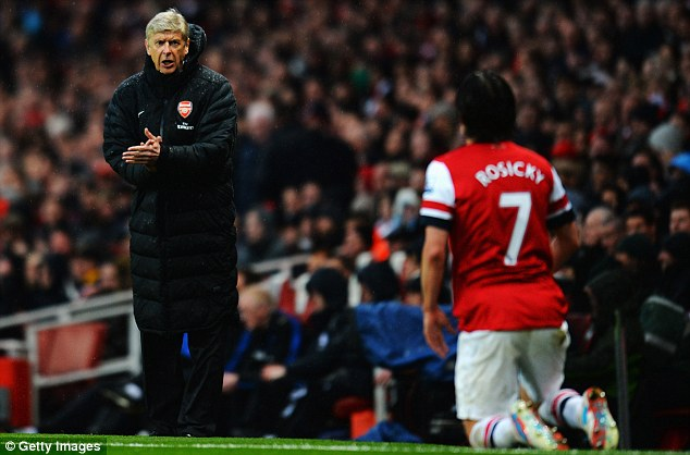 On his knees: Arsenal boss Arsene Wenger shows encouragement to Tomas Rosicky