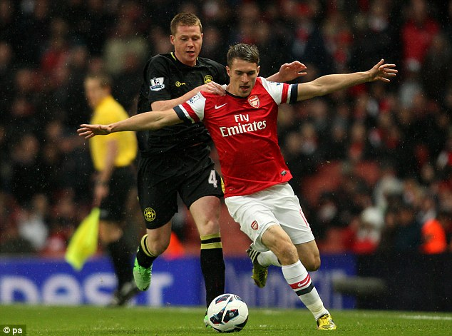 Fouled: Wigan's James McCarthy was penalised for a push on Arsenal's Aaron Ramsey