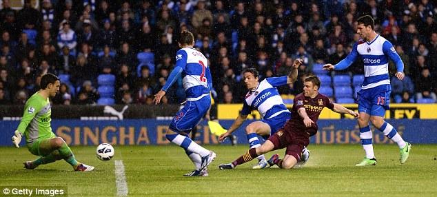 Top stop: Reading keeper Alex McCarthy denies Manchester City's James Milner