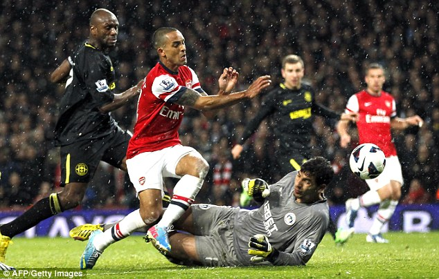 Back in front: Theo Walcott retakes the lead for Arsenal with a poacher's effort
