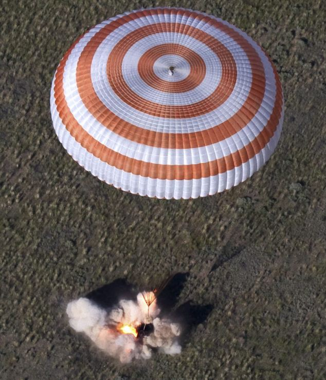 Touchdown! The Russian Soyuz space capsule lands some 150 kms southeast of the town of Dzhezkazgan in central Kazakhstan