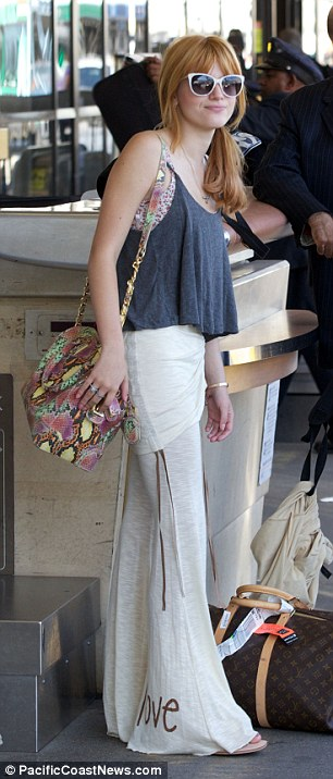 Comfort over fashion: The usually trend-conscious star seemed more concerned with being as dressed down and comfy as possible as she travelled to South Africa