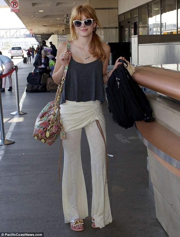 Hippie shake: Bella Thorne looked bohemian in baggy trousers as she caught her flight to South Africa from LA on Monday