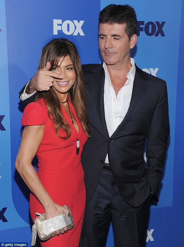 He nose best: Cowell openly flirted with judge Paula Abdul, seen here in 2011 promoting X Factor US