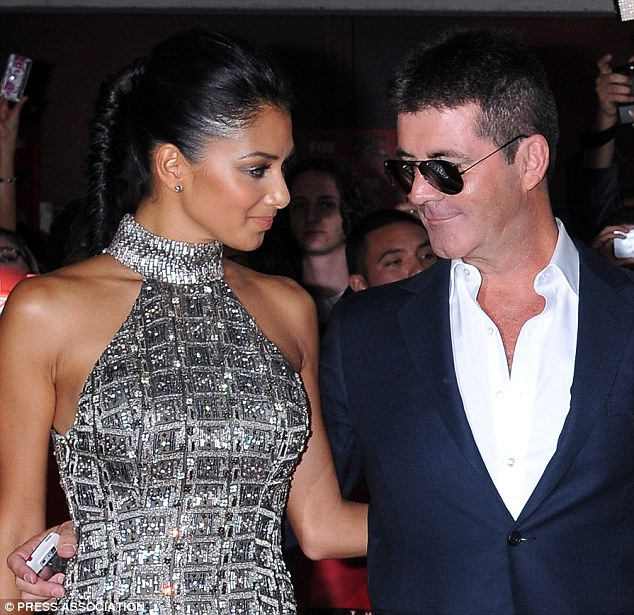 Eyes on the prize: Nicole Scherzinger was also a recipient of Simon's attentions
