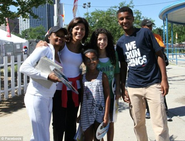 Support: Sambolin (second left) said she wanted to be there for her son (right) and daughter (center)