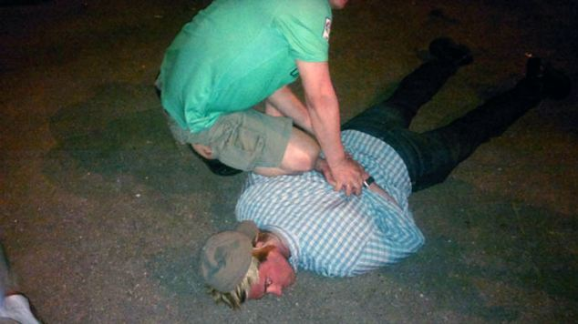 Arrested: The US diplomat was pinned to the ground and arrested by the Russian agent he was trying to recruit