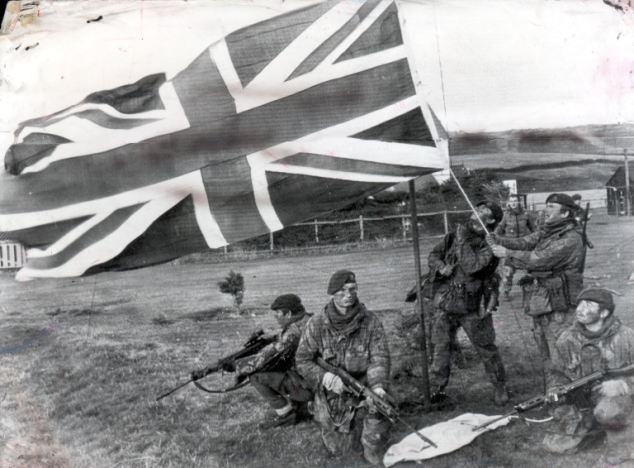 The Union flag flying over Port Howard, West Falkland, for the first time after the Falklands War started after being hoisted by 40 Commando, Royal Marine