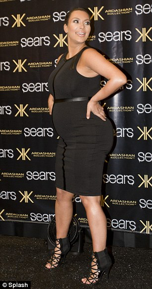 High and mighty: Now Kim reveals she is unable to wear her favourite high heels as her feet are too swollen