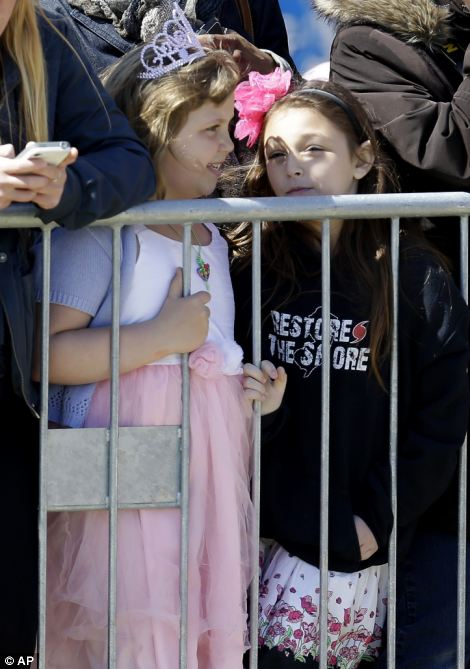 A British flag hangs from a barrier as people wait to catch a glimpse of Britain's Prince Harry during his visit to Casino Pier