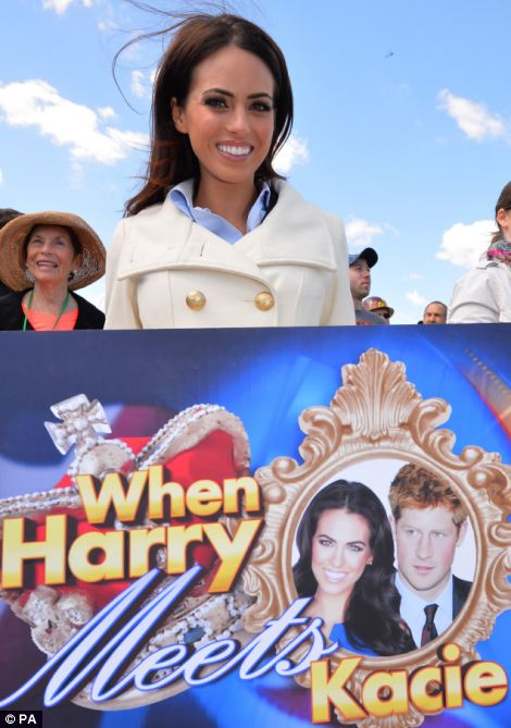 Fan: Kacie McDonnell holds up a sign as Prince Harry visits New Jersey on Tuesday morning