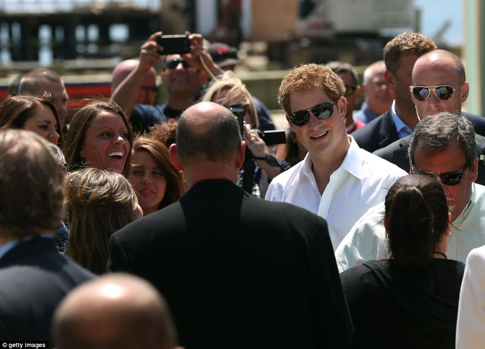 Warm welcome: Harry is pictured speaking with locals and emergency responders during his tour of Seaside Heights on the Jersey shore