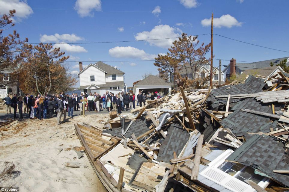 Debris: Prince Harry and Chris Christie stop to see damage along Barnegat Lane on a tour of areas of Ocean County