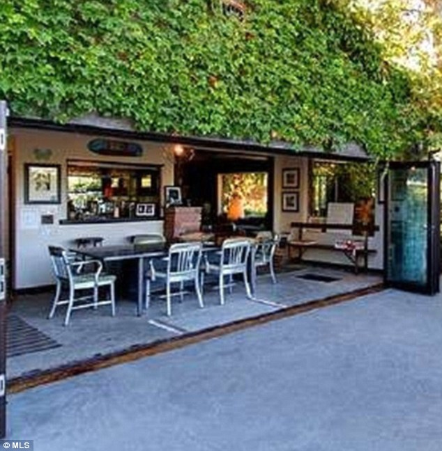 Embracing the outdoors: The ivy-draped home incorporates aspects of its lush surroundings