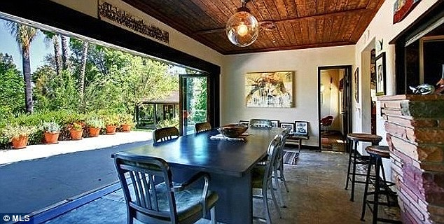 Letting the light in: A dining area features a retractable glass wall that can be opened to the patio