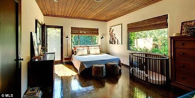 Sleeping arrangement's: The abode features three bedrooms accented by hardwood floors, exposed-beam ceilings and picture windows