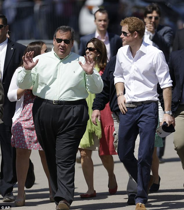 Looking the part: New Jersey Governor Chris Christie wore a green Oxford shirt that showed off his tan complexion during his tour of Mantoloking with Prince Harry
