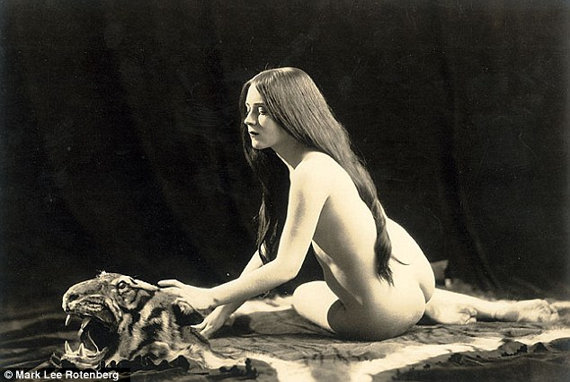 Animal instinct: Long hair was common in earlier pin-up images (pictured, 1920)