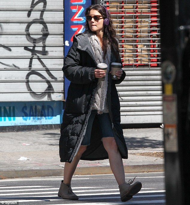 This used to be my neighbourhood! Katie Holmes grabs a coffee near an exclusive New York apartment block where she once lived with Tom Cruise on Tuesday
