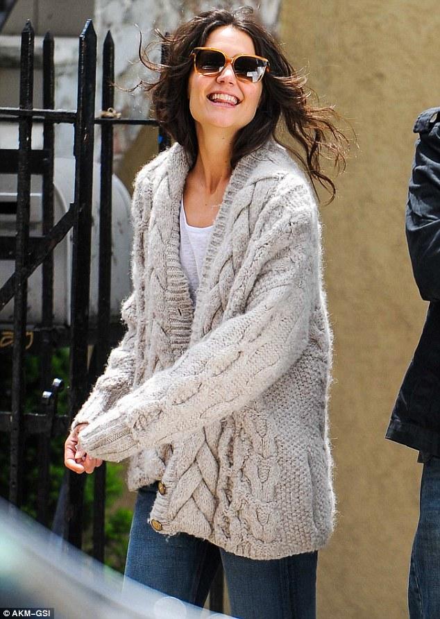Loving life: Katie looks happy as she takes a break between scenes