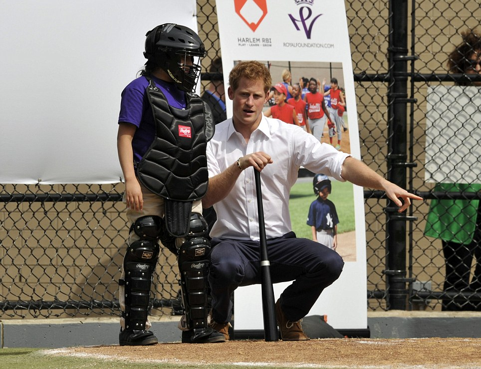 Tips from the top: Britain's Prince Harry participates in baseball drills with Harlem RBI's youth on the Field of Dreams during a visit to Harlem