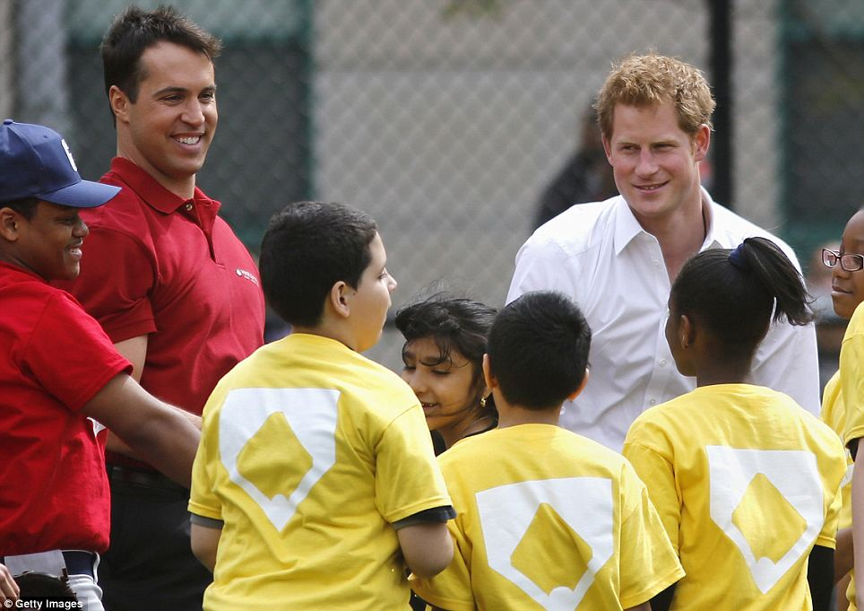Big smiles: Prince Harry, New York Yankee Mark Teixera, and some fun loving kids all grin as the royal takes part in a Harlem, New York community sports project