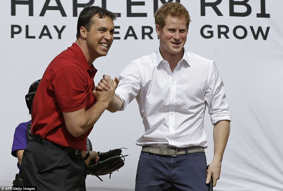 Dressy: Harry and Teixeira pose for press photos. Harry had just finished a tour in New Jersey with Governor Christie and was still in his suit as he played ball