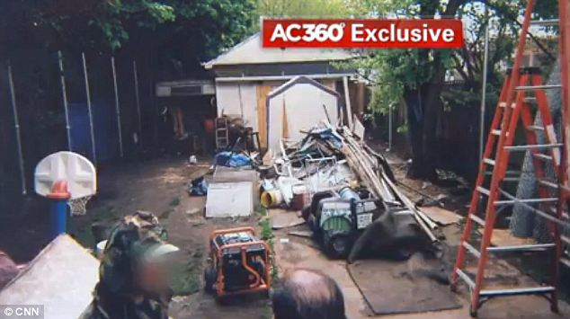 Wasteland: Photos show the heaping pile of random items left in Ariel Castro's backyard