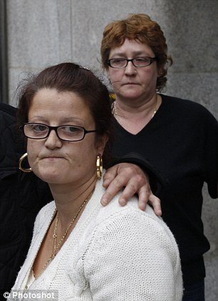 Family: Tia's mother Natalie Sharp is comforted by her partner David Niles while her mother, Tia's grandmother Christine Bicknell, stands behind her